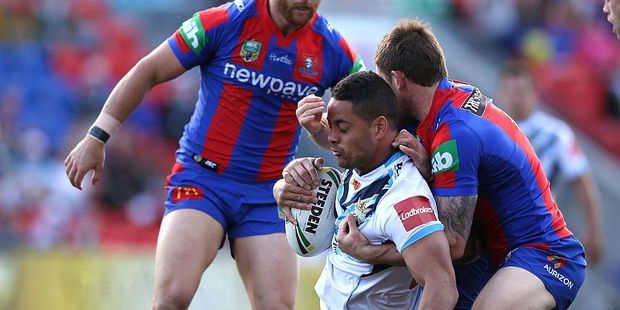 Jarryd Hayne of the Titans is tackled during the round 24 NRL match between the Newcastle Knights and the Gold Coast Titans. Photo / Getty Images