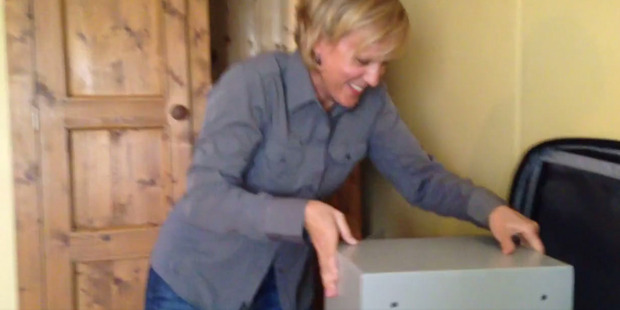 Hilary Barry puts the hotel safe into her suitcase.