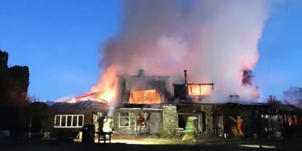Historic Cluden Station homestead in Tarras is consumed by fire last night. Photo: Mark Price / Otago Daily Times