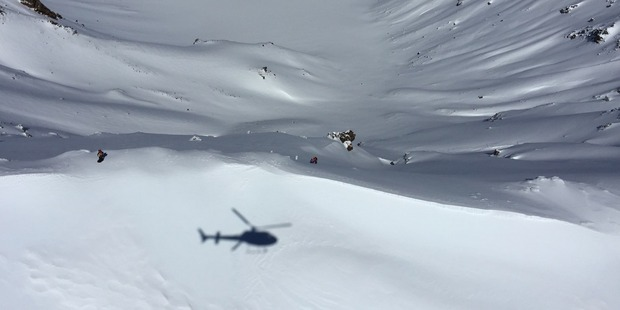 A woman is rescued near the summit of Mt Tongariro.  Photo / Barry Shepherd