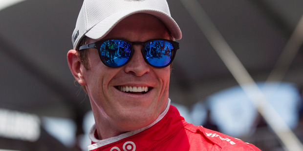 New Zealand's Scott Dixon smiles after winning the pole position in Toronto. Photo / AP