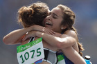 New Zealand's Nikki Hamblin, left, and United States' Abbey D'Agostino embrace after completing their heat in the Olympic 5000m. Photo / AP