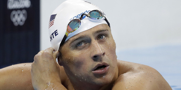 Lochte and three other American swimmers were robbed at gunpoint early Sunday, Aug. 14, by thieves posing as police officers who stopped their taxi and took their money and belongings. Photo / AP