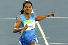 India's Dutee Chand, an athlete diagnosed as hyperandrogenic, competes in the women's 100 metre sprint at the Rio Olympics. Photo / AP