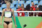 Canada's Brianne Eaton Theisen is encouraged by her husband Ashton Eaton of the United States, second right. Photo / AP
