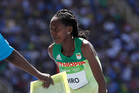 Etenesh Diro, of Ethiopia, leaves the track after her steeplechase race at the 2016 Rio Olympics. Photo / AP