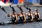 New Zealand's Jaimee Lovett, Kayla Imrie, Aimee Fisher and Caitlin Ryan paddle to shore after their opening race of the K2 500m event at the Rio Olympics. Photo / AP