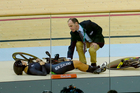 Olivia Podmore spectacularly crashed out of her heat in the women's keirin. Photo / AP