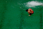 A diver takes part in a training session after the water in the diving pool turned green in the Maria Lenk Aquatic Centre at the 2016 Summer Olympics. Photo / AP