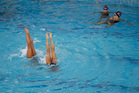 Synchronised swimming duet teams were relieved to find a clear, blue pool to practice their routines in this morning. Photo / AP