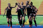 New Zealand's Gemma Flynn, left, celebrates scoring a goal during her side's 4-2 defeat of Australia in the Olympic hockey quarter-finals. Photo / AP