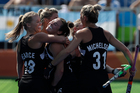 New Zealand's Kelsey Smith, centre, celebrates her goal against Australia in the Olympic women's hockey quarter final. Photo / AP