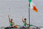 Gary O'Donovan and Paul O'Donovan, of Ireland, celebrate their silver in the men's rowing lightweight double sculls. Photo / AP