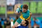 Australia's Henry Hutchison looks to break through a tackle during the 2016 Rio Olympics. Photo / AP