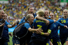 Sweden's players celebrate at the end of the semifinal match of the women's Olympic football tournament between Brazil and Sweden at the Maracana stadium. Photo / AP