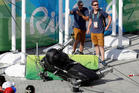 An overhead camera that fell from wires suspending it over Olympic Park lays on the ground. Photo / AP