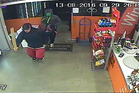 Two men, one carrying a length a wood, are shown in this CCTV still from a liquor store in Three Kings on Saturday night where two shop assistants were injured when attacked by the intruders.