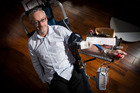 Edward Rooney gives blood at the New Zealand Trade Centre on Albert Street. Photo / Jason Oxenham