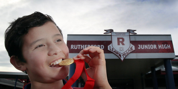 YOUNG LEADER: Kevin Rennie of Rutherford Junior High checks the metal of his medal after a presentation on Friday. PHOTO/STUART MUNRO