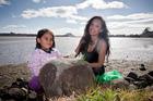 Kiri Danielle and Jessica Sio, 6, help clean the Waikareao Estuary. Photo/Andrew Warner
