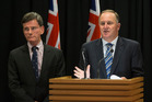 The Attorney General, Chris Finlayson, left, and Prime Minister John Key announcing changes to intelligence agency rules during a press conference. Photo / Mark Mitchell