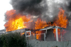 Fire destroyed the home on Dave and Rose Tohill on Nukumaru Parade in Waitotara on Friday.
