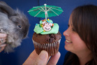 CUPCAKE DAY: Angus the rabbit and Rotorua SPCA office manager Nadine Brown with one of the creatively decorated cupcakes. PHOTO/STEPHEN PARKER