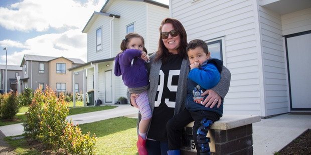 Waimahia Inlet residents, Melissa Moore and her 3-year-old twins. Photo / Nick Reed