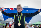 New Zealand's Lisa Carrington wins gold in the womens k1 200m at Lagoa Stadium, Olympic rowing. Photo / John Cowpland