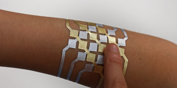 DuoSkin gold leaf pattern creates a computer circuit that allows the wearer to perfom functions with technology using bluetooth. Photo / Jimmy Day