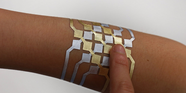 The tattoo creates a circuit allowing the wearer to perfom functions using bluetooth. Photo / Jimmy Day