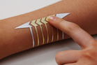 The smart tattoos apply to your skin like any $2 temporary tattoo.