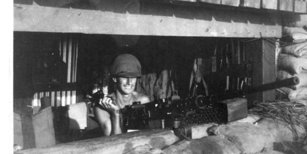 Mac McCallion takes his turn on guard duty. The weapon is a 50 calibre machine gun.