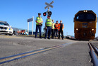 RAIL SMART: Constables Caleb Watt and Trevor Scarrow with Kiwirail driver Grant Allen and operations managers Karen MacDonald and Brian Fryer promoting Rail Safety Week. PHOTO/STUART MUNRO