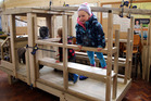 FUNHOUSE FAN: Pre-schooler Andie Burnette checks out the fire engine play house made by Whanganui City College students.