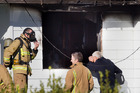 Fire investigators at the Petrie St address. Photo/Ben Fraser