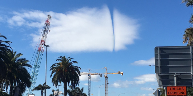 A plane causes this rip in the clouds. Snapped in Epsom across the road from Alexandra Park.