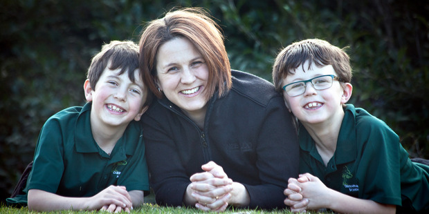 BLOOD: When Karen Wood gave birth for the second time on February 18, 2009, her placenta did not come out. Pictured with her sons Lincoln, 9 (left) and Noah, 7. PHOTO/Andrew Warner.