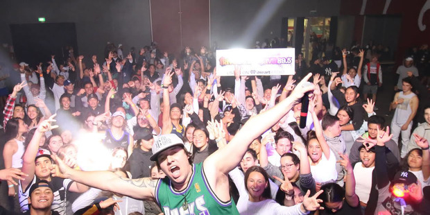 FUN: Rotorua youth and DJ ToneDef pose for a photo during the Pro Fresh Winter Bash. PHOTO/SUPPLIED