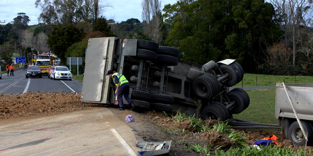 The driver and passenger of the rolled truck were injured in the crash at Brookby. Photo / Dean Purcell.
