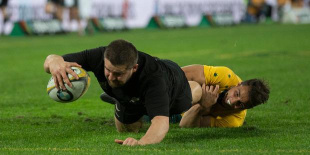 Dane Coles scores against Australia. Photo / Brett Phibbs