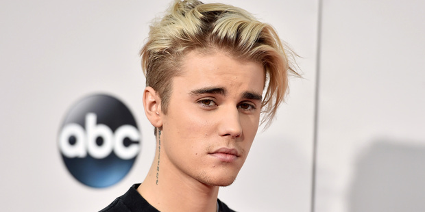 Justin Bieber has had enough with his fans saying hateful things about his new 'girlfriend'. Photo / AP