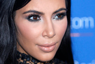 Kim Kardashian has explained why she gets injections in her behind. Photo / AP