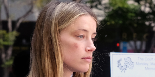 Actress Amber Heard sat through a seven-hour long deposition after claiming Johnny Depp was abusive toward her. Photo / AP