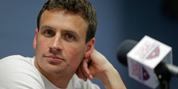 Ryan Lochte has apologised for his role in the robbery scandal that enveloped US swimming. Photo / AP