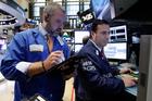 The Dow Jones gained 0.4 per cent, while the Nasdaq Composite Index advanced 0.6 per cent. Photo / AP