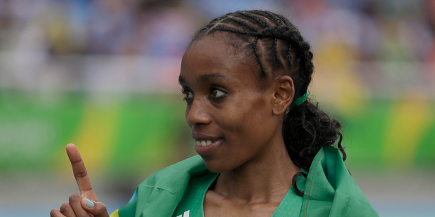 Ethiopia's Almaz Ayana celebrates winning the gold medal in the women's 10,000-meter during the Summer Olympics in Rio de Janeiro. Photo / AP.