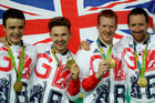 Britain's team, from right, Bradley Wiggins, Steven Burke, Edward Clancy and Owain Doull hold the gold medals on the podium of the Men's team pursuit final. Photo / AP.