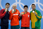 United States' silver medal winner Michael Phelps, Hungary's silver medal winner Laszlo Cseh, Singapore's gold medal winner Joseph Schooling and South Africa's silver medal winner Chad Le Clos, from left, in the men's 100-meter butterfly medals ceremony during the swimming competitions at the 2016 Summer Olympics. Photo / AP