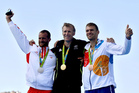 Silver medalist Damir Martin, of Croatia, left, bronze medalist Ondrej Synek, of the Czech Republic, right and gold medalist Mahe Drysdale, of New Zealand. Photo / AP.